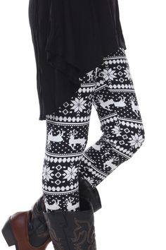 'Deer Valley' Print Leggings - Plan your February ski trip now and head over to Deer Valley Ski Resort and avoid the snowboarders. With it's upscale ambience, these classic black and white fair isle print leggings are the perfect base!  These pants feature a combination deer and snowflake motifs print. These leggings will keep you in style when you're ready to get off the slopes and into the cabin! Available in Black and White Print. 92% Cotton and 8% Spandex.