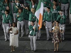 Ireland's flag bearer Katie Taylor holds the national flag as she leads the contingent in the athletes parade during the opening ceremony of the London 2012 Olympic Games at the Olympic Stadium in London England