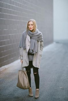Wrap yourself in an oversized scarf to add a cozy layer and some serious dimension to your look. #Fashion #WinterTrends