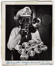 photographer weegee disguised as an ice cream peddler in theater, c. 1943