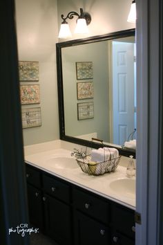 I never thought about framing the existing bland mirror in my bathroom, but I like how this makes it pop...so this DIY is coming to my bathroom mirror very soon!