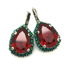 On Sale, Holiday Sale     Christmas Jewelry, Ruby Emerald Swarovski Drop Earrings-the perfect Christmas gift for her IF YOU WANT THE BEST CHOSE THE ORIGINAL Details : ♥ Materials- oxidized silver over brass CRYSTALLIZED™ Swarovski Element ♥ Wrapped and ready to give, arrives in our signature Petite Delights by Ilona Rubin® Box.( we can add a personalized note as well) ♥ leverback earrings ♥ Size 30.96 mm x 16.70 mm (1.21 x 0.66) ♥ Color Ruby Red, Emerald green ♥ Stones are hand set in…