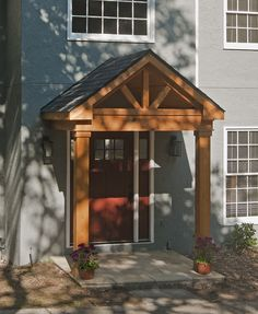 Timber frame portico with gable roof. Designed and built by Georgia Front Porch. Timber frame portico with gable roof. Designed and built by Georgia Front. Small Front Porches, Front Porch Design, Craftsman Front Porches, Front Porch Addition, Porch Designs, Portico Entry, Gable Roof Design, Porch Overhang, Veranda Design