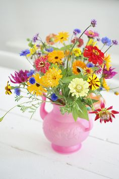 Get creative with how you display flowers - opt for something like an old tea kettle instead of a traditional vase
