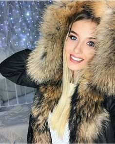 This listing if for the great new Real raccoon fur parka jacket for women. The parka coat is made of water proof fabric, decorated with big real raccoon fur hood and sides, lined with real rabbit or real sheered beaver fur (of your choice). Amazingly warm, soft and comfy outerwear!