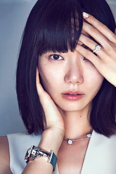 South Korean actress Doona Bae wearing Van Cleef & Arpels Cadenas Serie watch - white gold, diamonds, alligator bracelet and quartz movement - Fleurette Flowers necklace and ring - white gold and diamonds.  Photo by Richard Ramos at Fast Management.