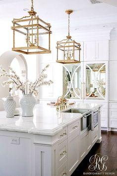 Brass pendants and white kitchen