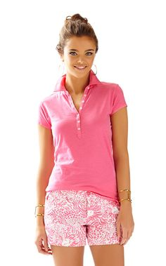 The Lila Polo is not your standard golf polo. This chic polo was designed with fashion in mind. It goes best with your favorite printed shorts. Love!