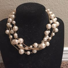 Long Pearl Necklace This necklace makes any outfit look and feel classy. It is extra long and has a mixture of different size pearls. Jewelry Necklaces
