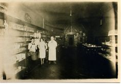 This photograph depicts Italian immigrant Dominick Meshotto, owner of Murfreesboro's Busy Bee Cafe, at its first location, 125 N. Maple Street. The first location of the restaurant operated from 1926 to 1934 before moving down the street. Also featured in this photograph behind the counter is Dominick's brother, Vance. An unidentified woman stands next to Dominick.