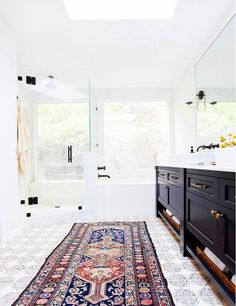 Gorgeous textile rug in place of a plain bathroom mat