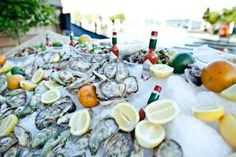 Nothing says summer like fresh seafood. At the Power Ball in Toronto, V.I.P. guests helped themselves to shrimp  and freshly shucked oysters at a chilled seafood bar provided by Petite Thuet.