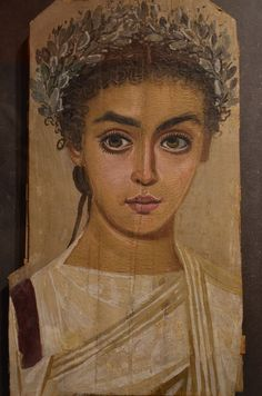 """Mummy portrait of a girl, from Roman Egypt. Artist unknown; ca. 120-150 CE. Now in the Liebieghaus, Frankfurt am Main, Germany. Photo credit: Carole Raddato. """""""