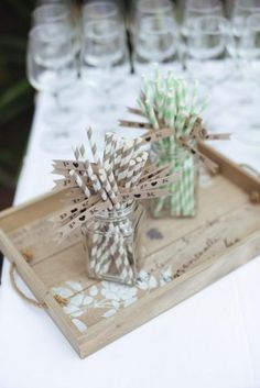 South African Wedding:  Distressed wooden tray with striped paper straws and drink flags