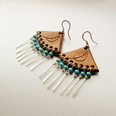 Tooled leather earrings, carved leaf, sterling silver and turquoise beads by Noria Elements