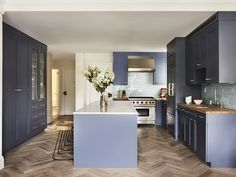 After: Although they had never used the cabinetry's blue paint color—Powell Gray by Benjamin Moore—before, Suzanne and Lauren knew it was a winner on sight. The blue-gray backsplash is by Ann Sacks Tile.