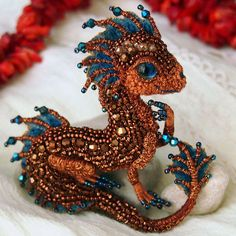 By now we've seen all kinds of dragons, from the ones made of felt to the wooden ones. Yet Russian master of embroidery, Alyona Lytvin, still managed to surprise us with her miniature dragons made out of beads.