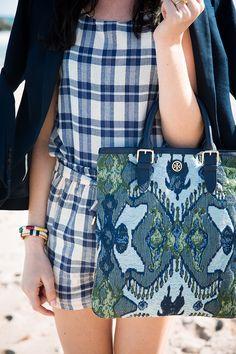 Blogger Classy Girls Wear Pearls carrying a Tory Burch Resort 15 bag
