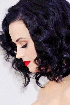 Dark purple hair. And red-hot lipstick.