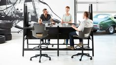 bivi modular desk system in black finish with 4 desks, arch accessory with upper and lower infills, fabric tackboard screens, freestanding power and shortcut office chairs