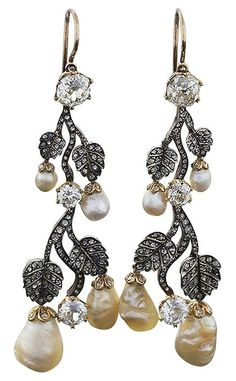 Antique European 18 karat gold and oxidized silver earrings with diamonds and pearls. The drop earrings have 6 old mine-cut diamonds with an approximate total weight of 4,60 carats, and 240 rose-cut diamonds with an approximate total weight of 2,00 carats, and 8 freshwater pearls. These ear pendants are designed in a naturalistic articulated fashion very popular in the 1860-1870's. Circa 1860's.
