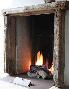 Rustic lintel,  simple fireplace.  Add big chair, warm pet, fat book. Mmmmmmm