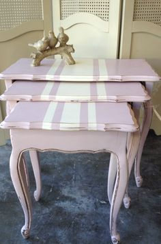 Nesting tables wearing Antoinette with stripe in Old White and clear wax. Inspired by One Girl In Pinks vintage suitcase.  Beautiful in Chalk Paint® decorative paint by Annie Sloan and available now at The Painted Attic.