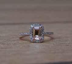 My future ring.  Emerald cushion cut peach - champagne sapphire in rose gold with diamond accents.