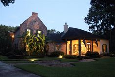 Stunning Custom Acadian Home Inspired By Renown Architect A. Hayes Town, Showcases Two Parapet Walls Made From Authentic Old Chicago Brick