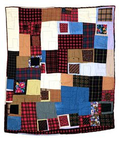 """PASSAGE QUILTS- by Sherri Lynn Wood  """"Roy Lewis""""  2002, Made for Megan Lewis out of her father's clothes."""