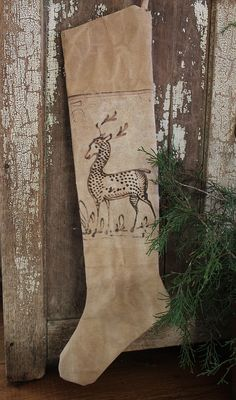 cinnamon creek dry goods   Canvas Deer Stocking About 22 ''..... this heavy canvas stocking has a wonderful old fraktur style deer image. Has a great look to it. 20.00 plus traveling fare SOLD