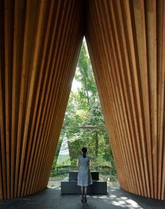Sayama Forest Chapel in Japan has sharply pointed gables constructed using larch wood beams