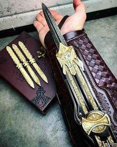 No photo description available. Swords And Daggers, Knives And Swords, Assassins Creed Cosplay, Pretty Knives, Armas Ninja, Hidden Blade, Ninja Weapons, Spy Weapons, Shuriken