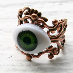 Green Eyeball - Patina Copper ($10) ❤ liked on Polyvore