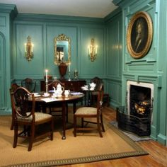Georgian room c. 1790 with mahogany furniture and table for morning coffee (York Castle Museum, York Museums Trust). I love the beautiful bright coloured walls.  The board and batten with a fireplace is typical of this period and provides a very elegant yet homely feeling to the room.