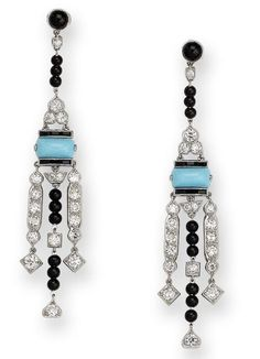 A pair of diamond, onyx and turquoise pendent earrings  Each cabochon onyx surmount suspending tassels of onyx beads and old brilliant-cut diamonds, connected by a central sugar loaf turquoise and calibré-cut onyx plaque and an old brilliant-cut diamond trefoil, diamonds approximately 2.60 carats total, length 7.9cm. Art Deco or Art Deco style.
