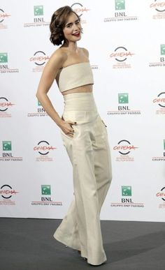 Lily Collins in Pamella Roland wide-legged trousers