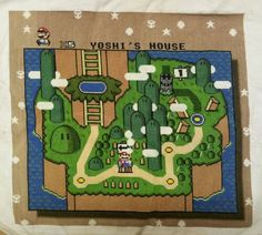 OMG! Opening map to Super Mario World in cross stitch. (by pan dimensional, via spritestitch.com) - this is the definition of awesome!
