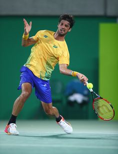 Thomaz Bellucci of Brazil in action against Pablo Cuevas of Uruguay during a Men's Singles Second Round match on Day 4 of the Rio 2016 Olympic Games at the Olympic Tennis Centre on August 9, 2016 in Rio de Janeiro, Brazil.