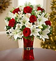 Red and white Christmas flowers featuring red roses and white lilies in a red vase with a Santa belt make the perfect Christmas floral arrangement! Christmas Flower Arrangements, Christmas Flowers, Christmas Centerpieces, Xmas Decorations, Floral Arrangements, Christmas Holidays, Christmas Wreaths, White Christmas, Christmas Vases