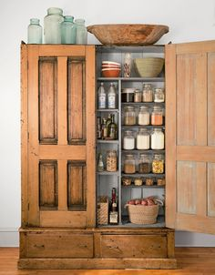 39 Ways to Sneak Storage Into Your Home To convert this armoire into a kitchen pantry, the owner of this Minneapolis loft added extra shelves and magnetic door closures. - Own Kitchen Pantry Stand Alone Kitchen Pantry, Kitchen Pantry Design, Kitchen Storage, Kitchen Decor, Pantry Storage, Extra Storage, Kitchen Organization, Space Kitchen, Kitchen Craft