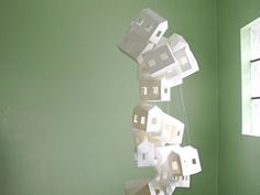 Hand-cut paper house mobile for modern nurseries....I just think it's cool in general
