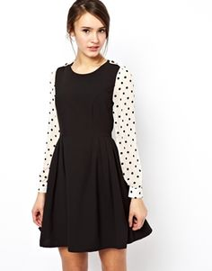 Darling Skater Dress With Polka Sleeves--I've already bought way too many black dresses lately, but this is SO cute.