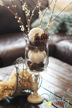White pumpkins and pinecones decor
