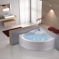 Une baignoire en acrylique et de forme arrondie. La profondeur du cuve masse et permet à votre corps de se détendre.  http://helpmaison.com/2014/05/14/helpmaison-vous-aide-a-realiser-la-salle-de-bain-de-vos-reves/