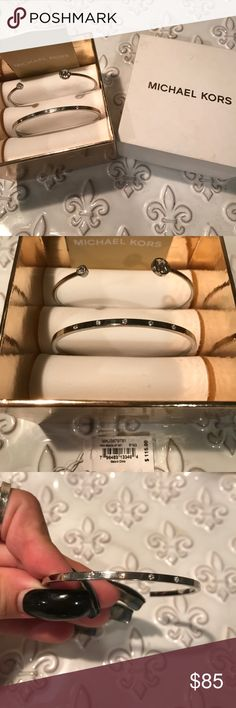 Michael Kors two-bracelet gorgeous set!!! Both bracelets are fabulous!!!  One has rhinestones around it and the other on says MK on one side and a single rhinestone on the other!!!  Wear them both on one arm or one on each!!!  Either way, YOU will look amazing!!! Michael Kors Jewelry Bracelets