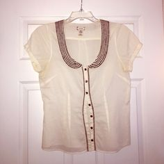 Precious Anthropologie Cream & Black Button Down Cream short sleeve button down blouse with black stitching from Anthropologie. Only worn a few times! This top is precious and perfect for the spring weather. Excellent condition! Anthropologie Tops Blouses