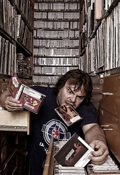 Jack Black with QOTSA album