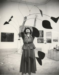 Peggy Guggenheim with an Alexander Calder mobile. Fantastic.