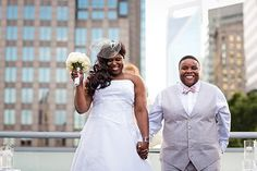 This couple was nearly overcome with emotion during a beautiful rooftop ceremony.